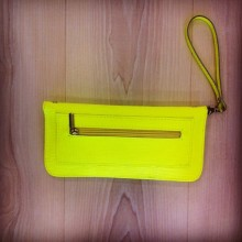 Neon yellow purse with zipper profile