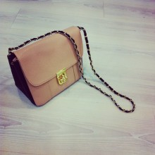 Bag with closure and long chain