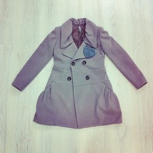 Sand-colored long coat button closure